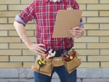 Construction worker holding clipboard for inspections