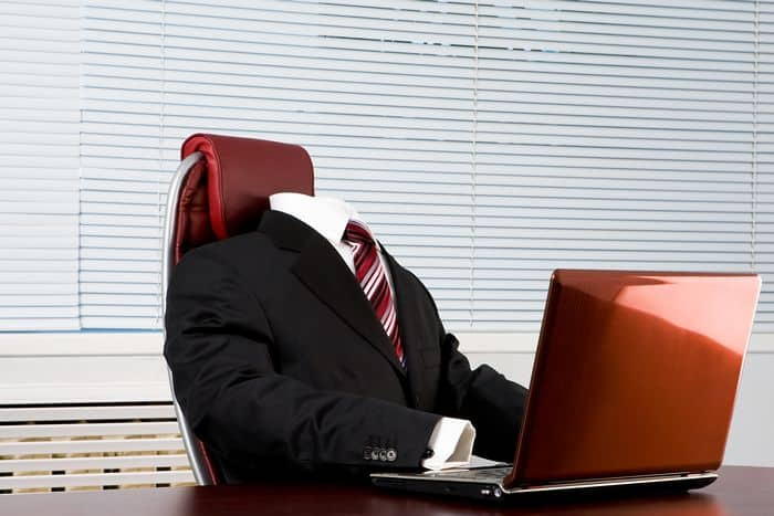 Invisible man in suit at desk, not getting promoted