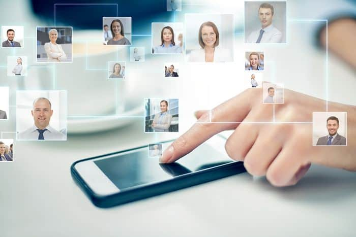 Project Contacts - phone with hand showing people's heads